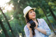 Beautiful asian girl smiling with digital camera photographing, Royalty Free Stock Images