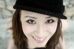 Beautiful Asian girl smiling sweetly Royalty Free Stock Photos