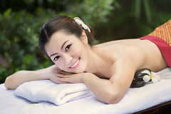 Beautiful Asian girl and spa Royalty Free Stock Photography
