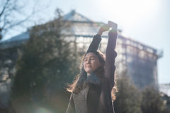 A beautiful Asian girl is standing in the park Stock Photos