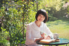 Beautiful asian girl studies in the garden Stock Photos