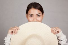 Beautiful Asian girl with sun hat in front of her Stock Photos