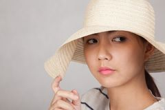 Beautiful Asian girl with sun hat Royalty Free Stock Photography
