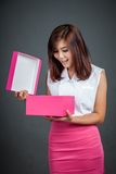 Beautiful Asian girl surprise open a pink gift box Stock Image