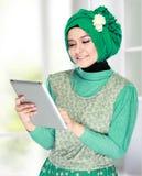 Beautiful asian girl with tablet computer Stock Photos