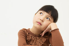Beautiful little young girl rest her chin on her hands Stock Photos