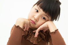 Beautiful little young girl rest her chin on her hands Royalty Free Stock Images