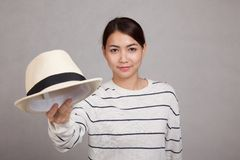 Beautiful Asian girl throw a  hat and smile Stock Images