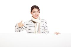 Beautiful Asian girl thumbs up  with scarf and blank sign Stock Images