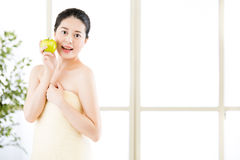 Beautiful asian girl, towel and fresh apple after bathing Royalty Free Stock Photos