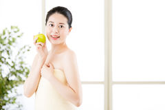 Beautiful asian girl, towel and fresh apple after bathing Royalty Free Stock Images