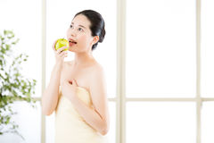 Beautiful asian girl, towel and fresh apple after bathing Stock Images