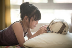 Beautiful asian girl using tablet Stock Images
