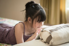 Beautiful asian girl using tablet Royalty Free Stock Images