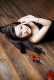 Beautiful asian girl with a violin Royalty Free Stock Images