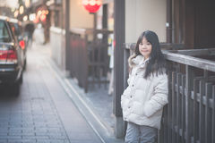 Beautiful asian girl waking in the street. Stock Images