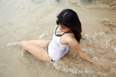 Beautiful Asian girl in the water Stock Photography