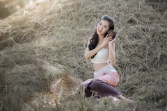 Beautiful asian girl  in the rice field. Beautiful asian girl wear a Thai traditional dress in the rice field Stock Images
