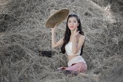 Beautiful asian girl  in the rice field. Beautiful asian girl wear a Thai traditional dress in the rice field Stock Photography