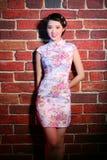Beautiful asian girl. Wearing pink flowers pattern chinese traditional dress Stock Photo