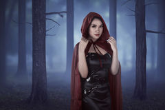 Beautiful asian girl wearing a red hooded cloak Stock Images
