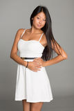 Beautiful Asian girl in white dress Royalty Free Stock Photography