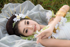 Beautiful Asian girl in white gown stock photos
