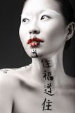 Beautiful Asian girl with white skin, red lips and stock images