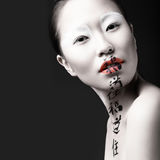 Beautiful Asian girl with white skin, red lips and royalty free stock photography