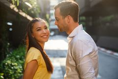 Asian girl and caucasian man together on the street stock images