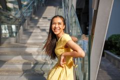 Beautiful Asian girl in a yellow dress royalty free stock image