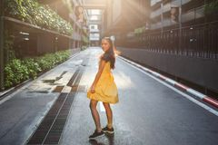 Beautiful Asian girl in a yellow dress royalty free stock photo