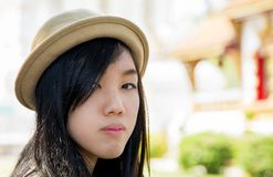 Beautiful asian girl. Beautiful young asian girl in buddhist thai temple Stock Photos