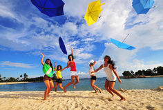 Beautiful Asian Girls having Fun at the Beach. Pictures of smiling faces at the beach. Suitable for joyful themes and bright contexts Royalty Free Stock Photos
