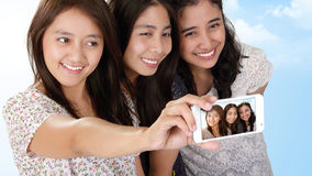 Beautiful Asian girls holiday selfie Stock Images