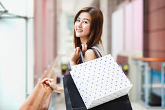 Beautiful asian girls with shopping bags royalty free stock images