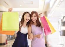 Beautiful girls shopping in the mall. Beautiful asian girls shopping in the mall Stock Image