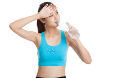 Beautiful Asian healthy girl with bottle of drinking water. Isolated on white background Royalty Free Stock Photos