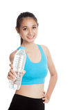 Beautiful Asian healthy girl with bottle of drinking water Royalty Free Stock Photography