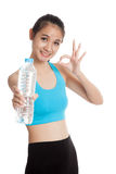 Beautiful Asian healthy girl with bottle of drinking water Royalty Free Stock Images