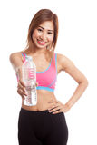 Beautiful Asian healthy girl with bottle of drinking water. Isolated on white background Stock Images
