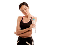 Beautiful Asian healthy girl with bottle of drinking water. Isolated on white background Stock Photography