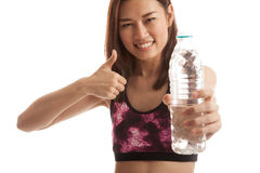 Beautiful Asian healthy girl with bottle of drinking water. Beautiful Asian healthy girl with bottle of drinking water  isolated on white background Royalty Free Stock Photo