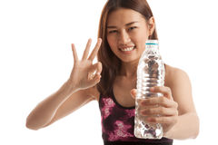 Beautiful Asian healthy girl with bottle of drinking water. Beautiful Asian healthy girl with bottle of drinking water  isolated on white background Stock Images