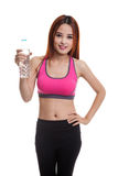 Beautiful Asian healthy girl with bottle of drinking water. Stock Photo