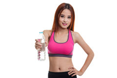 Beautiful Asian healthy girl with bottle of drinking water. Beautiful Asian healthy girl with bottle of drinking water  isolated on white background Stock Photo