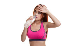 Beautiful Asian healthy girl with bottle of drinking water. Beautiful Asian healthy girl with bottle of drinking water  isolated on white background Royalty Free Stock Photos