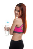 Beautiful Asian healthy girl with bottle of drinking water. Beautiful Asian healthy girl with bottle of drinking water  isolated on white background Royalty Free Stock Images