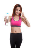Beautiful Asian healthy girl with bottle of drinking water. Beautiful Asian healthy girl with bottle of drinking water  isolated on white background Stock Photos