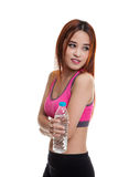 Beautiful Asian healthy girl with bottle of drinking water. Beautiful Asian healthy girl with bottle of drinking water  isolated on white background Stock Image